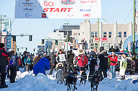 Martin Buser and team leave the ceremonial start line with an Iditarider and handler at 4th Avenue and D street in downtown Anchorage, Alaska on Saturday March 4th during the 2017 Iditarod race. Photo © 2017 by Brendan Smith/SchultzPhoto.com.