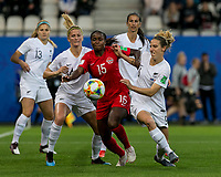 GRENOBLE, FRANCE - JUNE 15: Nichelle Prince #15 of the Canadian National Team and Rebekah Stott #6 of the New Zealand National Team battle for the loose ball, as Katie Bowen #14 of the New Zealand National Team looks on during a game between New Zealand and Canada at Stade des Alpes on June 15, 2019 in Grenoble, France.