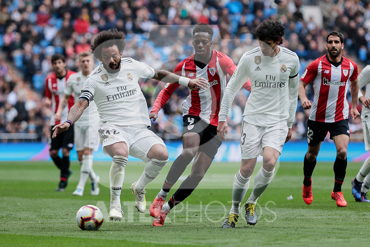 Real Madrid's Marcelo Vieira (L) and Jesus Vallejo (R) and Athletic Club de Bilbao's Inaki Williams during La Liga match between Real Madrid and Athletic Club de Bilbao at Santiago Bernabeu Stadium in Madrid, Spain. April 21, 2019. (ALTERPHOTOS/A. Perez Meca)