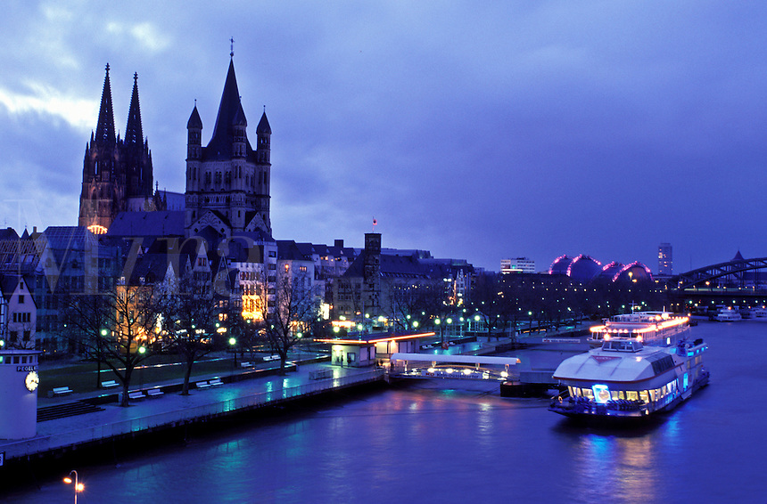 Germany, Cologne, Koln, Nordrhein-Westfalen, Rhine River, Europe, Scenic view of the city of Cologne (Koln) and the Cologne Cathedral (Dom) along the Rhine River in the evening.