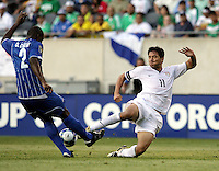 Brian Ching (11) slide tackles the ball away from Osman Chavez (2).  The US Men's National Team defeated Honduras 2-0 in the semifinals of the Gold Cup at Soldier Field in Chicago, IL on July 23, 2009.