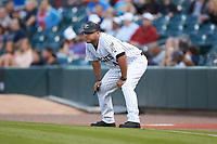 Charlotte Knights coach Guillermo Quiroz (40) coaches first base during the game against the Rochester Red Wings at BB&T BallPark on May 14, 2019 in Charlotte, North Carolina. The Knights defeated the Red Wings 13-7. (Brian Westerholt/Four Seam Images)