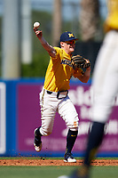 Michigan Wolverines shortstop Jack Blomgren (18) throws to first base during a game against Army West Point on February 17, 2018 at Tradition Field in St. Lucie, Florida.  Army defeated Michigan 4-3.  (Mike Janes/Four Seam Images)