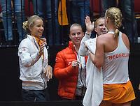 The Netherlands, Den Bosch, 16.04.2014. Fed Cup Netherlands-Japan, Kiki Bertens being congratulated by het team members Arantxa Rus, Rachel Hogenkamp and Michaella Krajicek, <br /> Photo:Tennisimages/Henk Koster