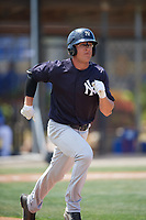 New York Yankees center fielder Blake Rutherford (23) runs to first base during a minor league Spring Training game against the Toronto Blue Jays on March 30, 2017 at the Englebert Complex in Dunedin, Florida.  (Mike Janes/Four Seam Images)