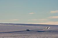 Commercial truck traverses the Arctic Coastal plains along the James Dalton Highway, Haul Road, Arctic, Alaska