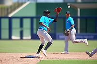 Miami Marlins shortstop Jazz Chisholm (1) stretches for a throw during an Instructional League game against the Washington Nationals on September 26, 2019 at FITTEAM Ballpark of The Palm Beaches in Palm Beach, Florida.  (Mike Janes/Four Seam Images)