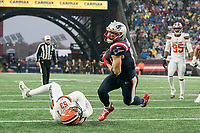 FOXBOROUGH, MA - OCTOBER 27: New England Patriots Wide Receiver Julian Edelman #11 pulls free of a low tackle by Cleveland Browns Linebacker Joe Schobert #53 and runs for a touchdown during a game between Cleveland Browns and New Enlgand Patriots at Gillettes on October 27, 2019 in Foxborough, Massachusetts.