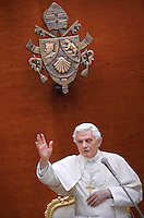 Pope Benedict XVI faces pilgrims gathered in the courtyard of his summer residence of Castelgandolfo, 40 km southeast of Rome, upon his arrival for a weekly general audience on August 10, 2011.