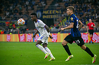 Milan, Italy - september 15 2021 - vinicius junior and nicolò barella in action during Inter- Real Madrid champions league