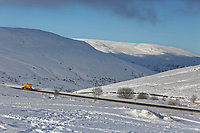 Pictured: A snow plough on the A470 at Storey Arms in the Brecon Beacons, Wales, UK. Monday 11 December 2017<br /> Re: Freezing temperatures, snow and ice has affected parts of the UK.