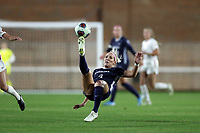 CHAPEL HILL, NC - NOVEMBER 29: Bridgette Andrzejewski #4 of the University of North Carolina clears the ball with an overhead kick during a game between University of Southern California and University of North Carolina at UNC Soccer and Lacrosse Stadium on November 29, 2019 in Chapel Hill, North Carolina.