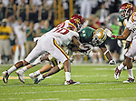 Baylor Bears running back Terrance Ganaway (24) and Iowa State Cyclones defensive back Jacques Washington (10) in action during the game between the Iowa State Cyclones and the Baylor Bears at the Floyd Casey Stadium in Waco, Texas. Baylor defeats Iowa State 49 to 26.