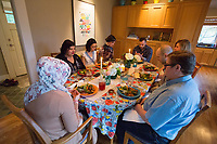 """SEATTLE, WA-APRIL 17, 2017: Amanda Saab, along with her husband Hussein Saab, host a """"dinner with your Muslim neighbor"""" at the home of Stefanie and Nason (cq) Fox in Seattle, WA on a return trip April 17th 2017. The couple now live in Detroit. The guests are <br /> Anjana Agarwal (black top), Patricia Rangel (black top with pattern), and Greg and Charissa (white top) Pomrehn.<br /> <br /> (Photo by Meryl Schenker/For The Washington Post)"""