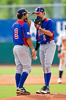 Shortstop CJ Hinojosa #2 of NABF chats with pitcher Stephen Gant #1 at the 2011 Tournament of Stars at the USA Baseball National Training Center on June 25, 2011 in Cary, North Carolina.  The Stars defeated NABF 7-1.  (Brian Westerholt/Four Seam Images)