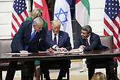 """Prime Minister Benjamin Netanyhu of Israel; United States President Donald J. Trump and Sheikh Abdullah bin Zayed bin Sultan Al Nahyan, Minister of Foreign Affairs and International Cooperation of the United Arab Emirates sign the """"Abraham Accords"""" on the South Lawn of the White House in Washington, DC on Tuesday, September 15, 2020. <br /> Credit: Chris Kleponis / Pool via CNP"""