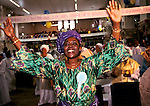 """CELESTIAL CHURCH OF CHRIST, SOUTH LONDON, HARVEST FESTIVAL. This west African church was founded by S B J Oshoffa Mainly attended by Yoruba people from western Nigeria the church  flourishes with offshoots in London Paris and New York This  photograph is taken from the book The Storm is Passing Over"""""""