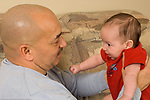 3 month old baby boy with father, interaction, held face to face with him, talked to