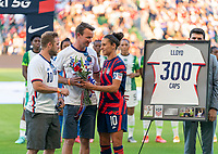 AUSTIN, TX - JUNE 16: Carli Lloyd #10 of the USWNT poses with her family before a celebration of her 300th cap during a game between Nigeria and USWNT at Q2 Stadium on June 16, 2021 in Austin, Texas.