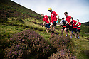 14/09/19<br /> <br /> With only glory and a full barrel beer for the winning team, competitors haul a full seventy-two pint beer barrel up and across one of the toughest areas of high moorland in the Peak District National Park at the start of the Great Kinder Beer Barrel Challenge.<br /> <br /> The mountain known as Kinder Scout, scene of the famous mass trespass in 1932, plays host to one of the most gruelling fell-running events to be run on the Dark Peak hills, Derbyshire.<br /> <br /> The Great Kinder Beer Barrel Challenge has its roots in a bet that occurred in 1998. The original challenge was laid down one bleak January night when local Edale shepherd Geoff Townsend complained to the landlord at the Old Nags Head Inn that they had run out of his favourite beer. Geoff jokingly offered to fetch a barrel of the brew from the Snake Pass Inn, only three miles away as the crow flies, but with 900ft of ascent and descent in between. The landlord agreed that if Geoff succeeded, he could have the barrel (and, more importantly, its contents). So the thirsty shepherd gathered twelve locals to help carry the barrel on a borrowed Mountain Rescue stretcher. He won the bet, shared the beer with his team,<br /> <br /> All Rights Reserved: F Stop Press Ltd.  <br /> +44 (0)7765 242650 www.fstoppress.com