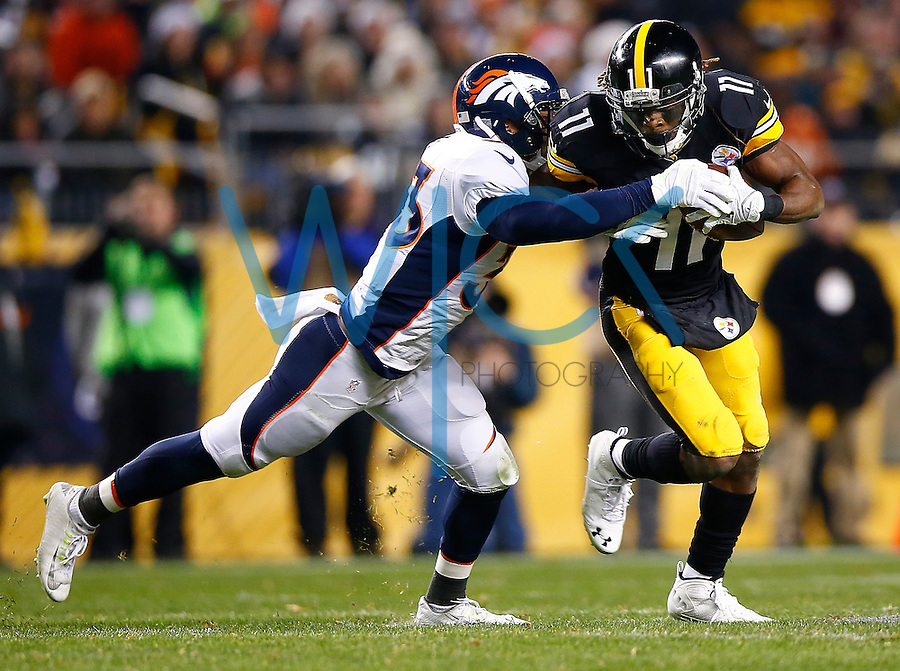 Markus Wheaton #11 of the Pittsburgh Steelers runs after catching a pass in front of Shiloh Keo #33 of the Denver Broncos in the second half during the game at Heinz Field on December 20, 2015 in Pittsburgh, Pennsylvania. (Photo by Jared Wickerham/DKPittsburghSports)