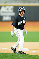 Joey Rodriguez (7) of the Wake Forest Demon Deacons takes his lead off of third base against the North Carolina State Wolfpack at Wake Forest Baseball Park on March 16, 2013 in Winston-Salem, North Carolina.  The Demon Deacons defeated the Wolfpack 13-4.  (Brian Westerholt/Four Seam Images)