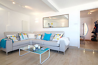 BNPS.co.uk (01202) 558833. <br /> Pic: KnightFrank/BNPS<br /> <br /> Pictured: Living space. <br /> <br /> The ultimate room with a view...<br /> <br /> A former fish cellar that is now an idyllic waterfront home overlooking a famous Cornish beach is on the market for £930,000.<br /> <br /> The ground floor apartment is in a prime frontline position with exceptional panoramic views over Porthmeor Beach and out to sea.<br /> <br /> Estate agent Christopher Bailey said the window in the reception space is like having your own live television screen looking out on the action of the beach.<br /> <br /> It has been designed and renovated to an exceptionally high standard and the immaculate flat is currently rented out for short holiday let, making about £40,000 profit a year.