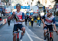 "Ryan Mullen (IRE/Trek-Segafredo) happily carries the prosecco bottle he got from his teammate/friend Jasper Stuyven (BEL/Trek-Segafredo) who just won ""La Classicissima""<br /> <br /> 112th Milano-Sanremo 2021 (1.UWT) <br /> 1 day race from Milan to Sanremo (299km)<br /> <br /> ©kramon"