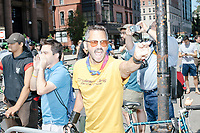 """A man shouts """"Shame"""" and """"Hater"""" as counterprotesters hold signs toward, flip-off, and angrily shout at those marching in the Straight Pride Parade in Boston, Massachusetts, on Sat., August 31, 2019. The parade was organized in reaction to LGBTQ Pride month activities by an organization called Super Happy Fun America."""