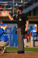 Umpire David Arrieta makes a call during a game between the Hudson Valley Renegades and Batavia Muckdogs on August 7, 2013 at Dwyer Stadium in Batavia, New York.  Batavia defeated Hudson Valley 15-6.  (Mike Janes/Four Seam Images)