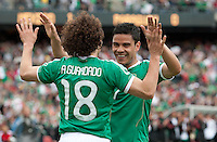 Andres Guardado (left) celebrates his goal with Pablo Barrera (right) Mexico defeated Paraguay 3-1 at the Oakland Coliseum in Oakland, California on March 26th, 2011.