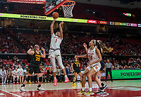 COLLEGE PARK, MD - FEBRUARY 13: Shakira Austin #1 of Maryland tosses in a shot in front of Monika Czinano #25 during a game between Iowa and Maryland at Xfinity Center on February 13, 2020 in College Park, Maryland.