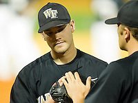Austin Stadler #9 of the Wake Forest Demon Deacons is greeted by teammate Daniel Marrs #16 after being taken out of the game against the Miami Hurricanes at Gene Hooks Field on March 18, 2011 in Winston-Salem, North Carolina.  Photo by Brian Westerholt / Four Seam Images
