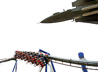 Thrill seekers ride a roller coaster at Carowinds theme park near Charlotte NC.