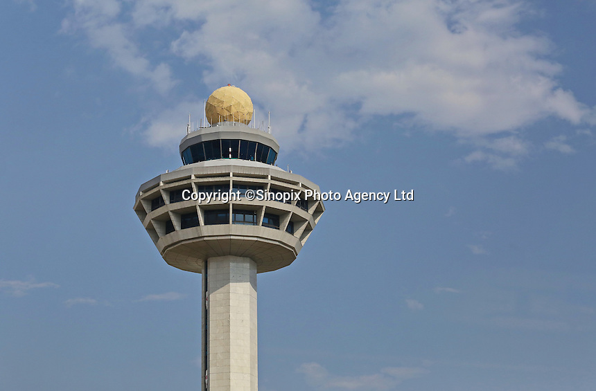 Changi Airport air traffic control tower. The iconic tower is situated between Changi International Airport 2 runways and stands at about 81 m Above Mean Sea Level (AMSL). It provides aerodrome control service to aircraft landing and departing Changi Airport and aircraft manoeuvring within the airport. It handles about 700 aircraft movements daily.