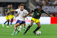DALLAS, TX - JULY 25: Matthew Hoppe #13 of the United States Damion Lowe #17 of Jamaica battle for ball during a game between Jamaica and USMNT at AT&T Stadium on July 25, 2021 in Dallas, Texas.