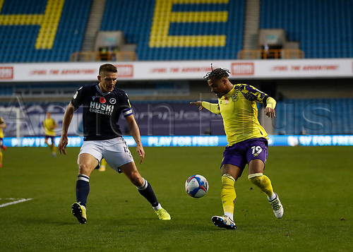 31st October 2020; The Den, Bermondsey, London, England; English Championship Football, Millwall Football Club versus Huddersfield Town; Josh Koroma of Huddersfield Town being marked by Shaun Hutchinson of Millwall