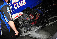 Jun. 19, 2011; Bristol, TN, USA: Fire extinguisher sprays from beneath the body on the NHRA funny car of Robert Hight after winning the Thunder Valley Nationals at Bristol Dragway. Mandatory Credit: Mark J. Rebilas-