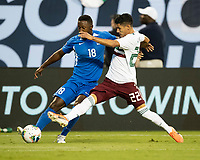 CHARLOTTE, NC - JUNE 23: Uriel Antuna #22 contests the ball against Samuel Camille #18 during a game between Mexico and Martinique at Bank of America Stadium on June 23, 2019 in Charlotte, North Carolina.