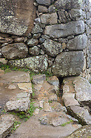 Peru, Machu Picchu.  Canal Bringing Water from a Mountain Spring to the Inner City, Passing under the Outer Wall.