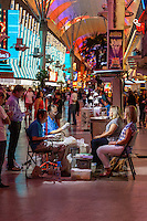 Las Vegas, Nevada.  Fremont Street.  Sculptors Molding Statuettes of Customers.