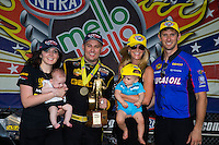 Sept. 1, 2014; Clermont, IN, USA; NHRA top fuel dragster driver Richie Crampton celebrates with daughter Emma Crampton and girlfriend Stephanie Laski and team owner Morgan Lucas with wife Katie Lucas and son Hunter Lucas after winning the US Nationals at Lucas Oil Raceway. Mandatory Credit: Mark J. Rebilas-USA TODAY Sports