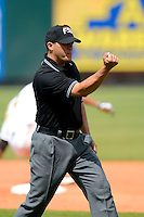 Umpire Fernando Rodriguez makes a call during a game between the Bradenton Marauders and Fort Myers Miracle at McKechnie Field on April 7, 2013 in Bradenton, Florida.  Fort Myers defeated Bradenton 9-8 in ten innings.  (Mike Janes/Four Seam Images)