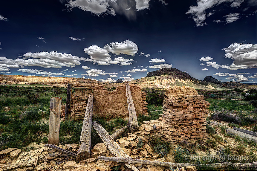An old, abandoned, eroded adobe ruin in the Rio Puerco Valley, of northwestern New Mexico with Cerro Santa Clara, Cerro Guadalupe and Cabezon Peak in the background.