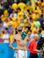 BRASILIA - BRASIL -19-06-2014. Foto: Daniel Jayo / Archivolatino<br /> Mario Yepes jugador de Colombia (COL) celebra la victoria sobre Costa de Marfil (CIV) en partido del Grupo C de la Copa Mundial de la FIFA Brasil 2014 jugado en el estadio Mané Garricha de Brasilia./ Mario Yepes player of Colombia (COL) celebrates the victory over Ivory Coast (CIV) in macth of the Group C of the 2014 FIFA World Cup Brazil played at Mane Garricha stadium in Brasilia. Photo:  Daniel Jayo / Archivo Latino<br /> VizzorImage PROVIDES THE ACCESS TO THIS PHOTOGRAPH ONLY AS A PRESS AND EDITORIAL SERVICE IN COLOMBIA AND NOT IS THE OWNER OF COPYRIGHT; ANOTHER USE IS REPONSABILITY OF THE END USER. NO SALES, NO MERCHANDASING. ALL COPYRIGHT IS ARCHIVOLATINO