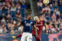 FOXBOROUGH, MA - SEPTEMBER 21: Cristian Penilla #70 of New England Revolution and Kelyn Rowe #6 of Real Salt Lake battle for head ball during a game between Real Salt Lake and New England Revolution at Gillette Stadium on September 21, 2019 in Foxborough, Massachusetts.