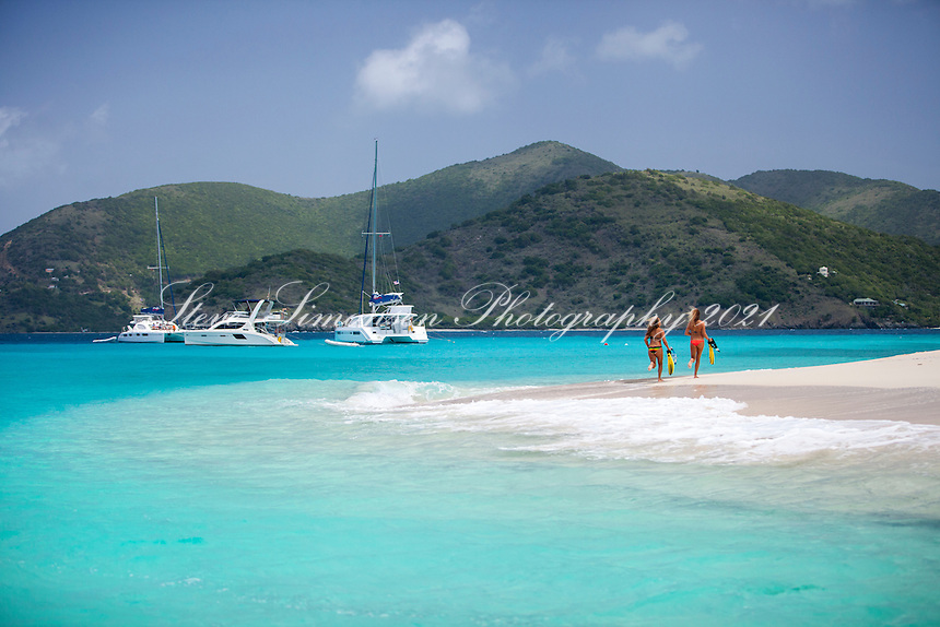 Two girls walking the shore at Sandy Cay<br />