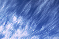 Wisps of finely veiled cirrus clouds whip overhead riding a 200mph jet stream at around thirty-thousand feet over central Oklahoma.