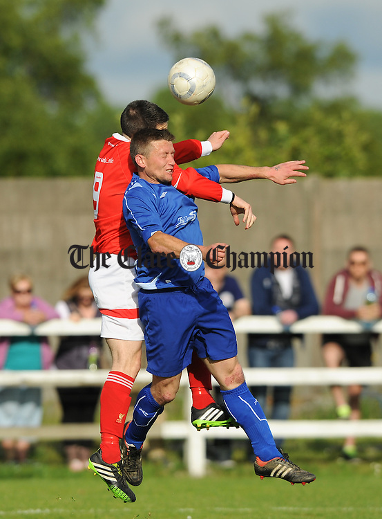 Adrian Walsh of Ennis Town A in action against Eoin Hayes of Newmarket Celtic A during the Clare Cup final at the County Grounds. photograph by John Kelly.
