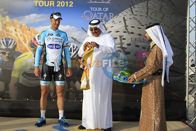 Omega Pharma-Quick Step rider Tom Boonen (BEL) retains the leaders yellow jersey at the end of the 2nd Stage of the 2012 Tour of Qatar an 11.3km team time trial at Lusail Circuit, Doha, Qatar. 6th February 2012.<br /> (Photo Eoin Clarke/Newsfile)